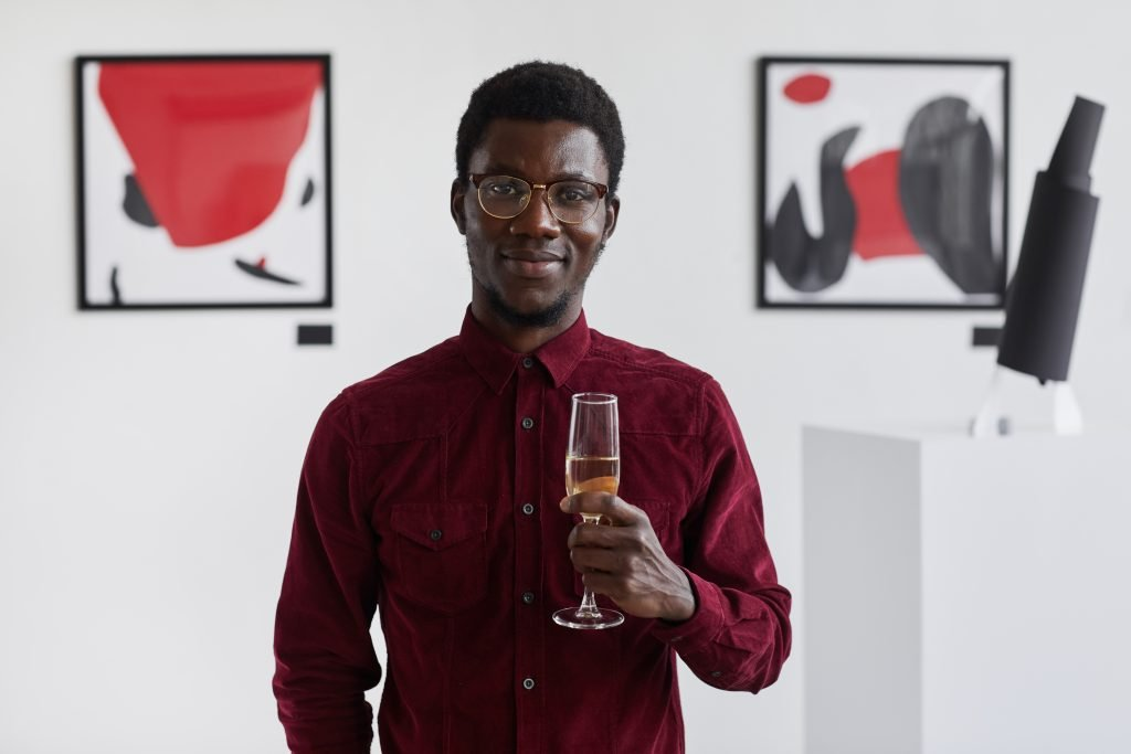 Waist,Up,Portrait,Of,Smiling,African-american,Man,Holding,Champagne,Glass